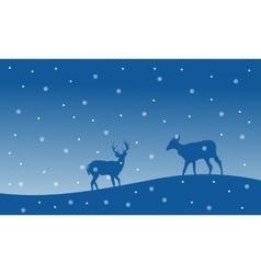 Silhouette of deer with snowfall Christmas scenery vector image