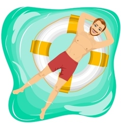handsome man floating on an inflatable circle vector image
