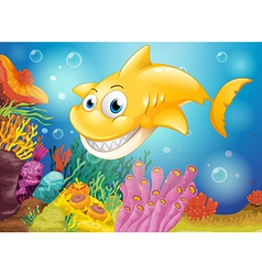 A smiling yellow shark under the sea vector image