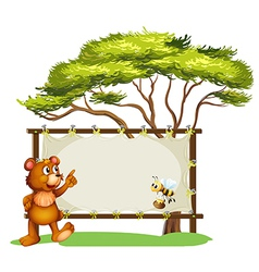 A notice board a bear and a honey bee vector image