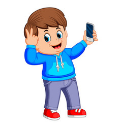 boy holding his smartphone with his hand vector image