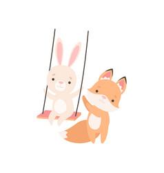 Lovely white little bunny swinging on rope swing vector