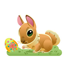 Easter bunny with the egg on the grass cartoon vector