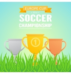 Trophy cups on field grass vector