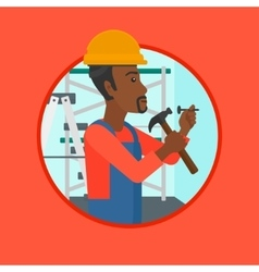 Worker hammering nail vector image