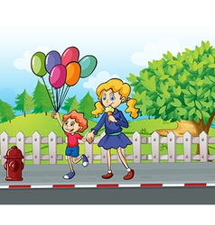 A young boy with balloons and a girl eating an ice vector image