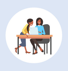businesswomen coworkers sitting at workplace desk vector image