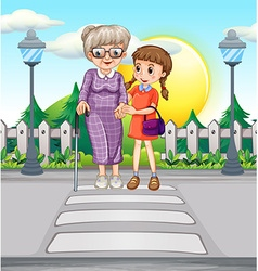 Girl helping old woman crossing the road vector