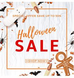 Halloween sale background with treats vector
