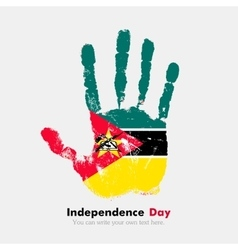 Handprint with the flag of mozambique in grunge vector