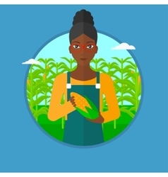 Farmer holding corn vector