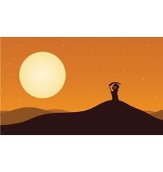 Silhouette of halloween warlock in hills vector image