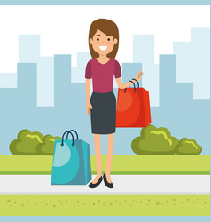 woman with shopping bags in the park vector image