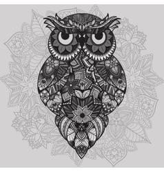 Patterned owl on the ornamental mandala vector