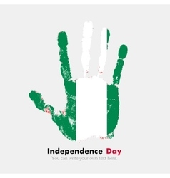 Handprint with the Flag of Nigeria in grunge style vector image
