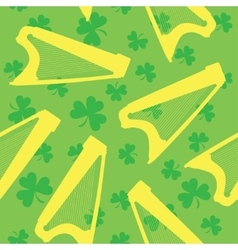 Seamless pattern with celtic harp and shamrock on vector image vector image