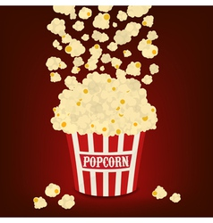popcorn falling in the striped bag vector image