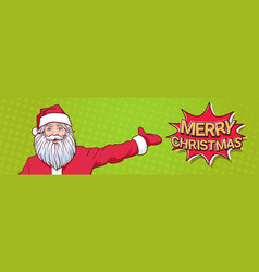 santa claus pointing hand to marry christmas sign vector image