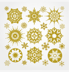 collection of golden snowflakes on a white vector image