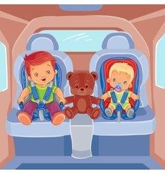 Two little boys sitting in child car seats vector image