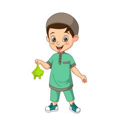 Happy muslim boy cartoon holding a ketupat vector