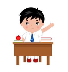 Schoolboy sitting behind desk in school class vector