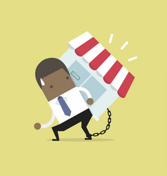 businessman carry his shop debt with chained vector image