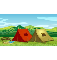 Camping tents near the mountain vector image