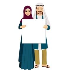 Emirati couple holding empty blank board vector image vector image