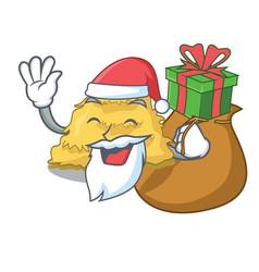 Santa with gift hay bale mascot cartoon vector