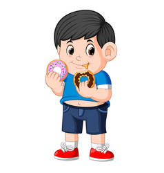 Little happy cute boy is eating two donut vector