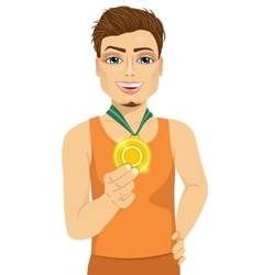 Male athlete showing his gold medal vector