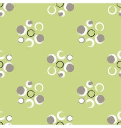 Grunge circles on a light green background vector image