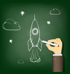 human hand drawing chalk on a blackboard a rocket vector image