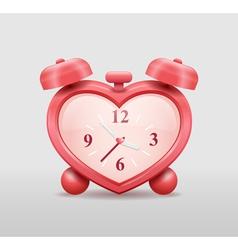 Alarm clock in heart shape vector