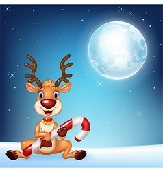 Cartoon of baby deer holding Christmas candy vector