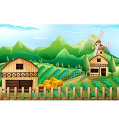 Farmland with barn and windmill vector