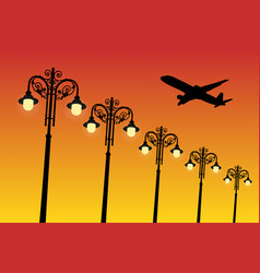 Flying aircraft and vintage lampposts at sunset vector