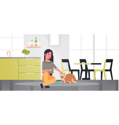 Woman feeding hungry cat girl giving her kitty dry vector
