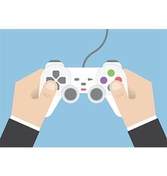 Businessman hand holding joystick vector image