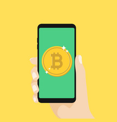 Hand holding smartphone with bitcoin currency vector