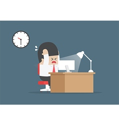Businessman working overtime at his desk vector image