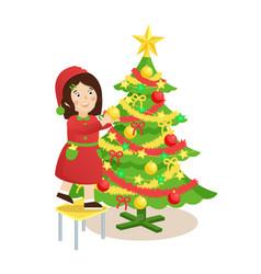 girl decorating christmas tree vector image