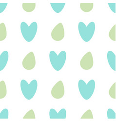 seamless pattern with colored eggs and hearts on a vector image