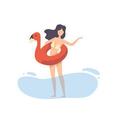 beautiful girl in bikini with flamingo inflatable vector image