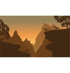 Silhouette of eoraptor in cliff vector image