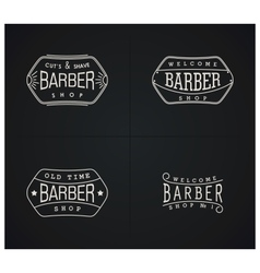 Set of four retro emblems for Barber Shop vector