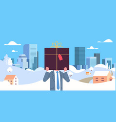 businessman holding gift box in front face vector image