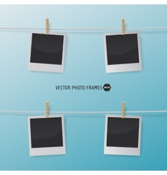 Retro photo frames on a rope with clothespins vector