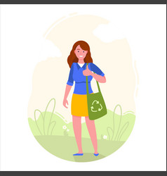 Girl is holding eco bag with recycling symbol vector
